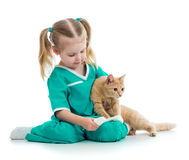 Kid playing doctor with cat Stock Photos