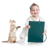 Kid playing doctor with cat Stock Photo