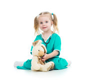 Child playing doctor and examining toy Stock Photography