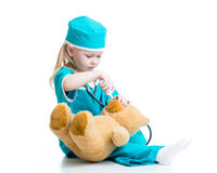 Kid playing a doctor isolated on white Royalty Free Stock Photo