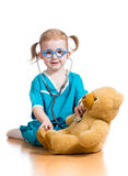 Kid playing doctor with toy Royalty Free Stock Photo