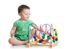 Kid playing with educational toy Stock Photos