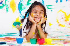Kid playing with finger paints Stock Photography