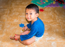 Kid playing on the floor Stock Image