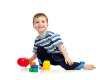 Kid playing on floor on white background Stock Photo