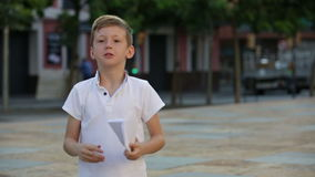 Kid playing with flying paper planes stock footage