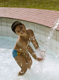 Kid playing with fountain Stock Photo