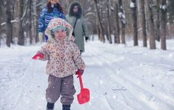 Kid playing in a winter park and have fun with family royalty free stock photos