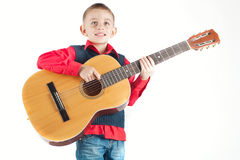 Kid playing the guitar Stock Photos