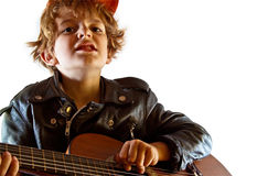 Kid playing guitar Royalty Free Stock Photos
