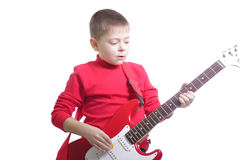 Kid playing guitar. Kid in red playing guitar isolated over white Stock Image