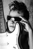 Kid playing guitar Stock Image