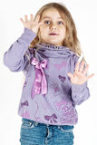 Kid playing with hands. Portrait of a kid playing with hands isolated on white background Stock Images