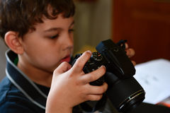Kid playing with his camera Stock Image