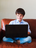 Kid playing with his laptop Royalty Free Stock Photography