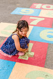 Kid Playing Hopscotch / Kid Playing Hopscotch on Playground Stock Photography