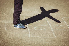 Kid playing hopscotch on playground Stock Photography