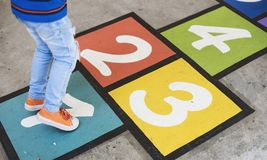 Kid playing hopscotch at school Royalty Free Stock Photography