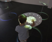 Kid playing with interactive installation at Expo 2015 in Milan, Stock Photography
