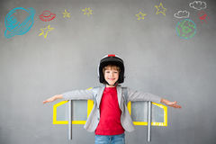 Kid playing with jet pack at home. Kid with jet pack. Child playing at home. Success, imagination and innovation technology concept Royalty Free Stock Image