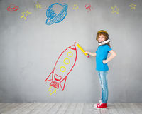 Kid playing with jet pack at home Stock Image