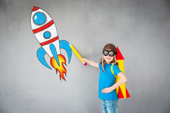 Kid playing with jet pack at home royalty free stock images