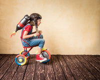 Kid playing with jet pack at home Royalty Free Stock Photo