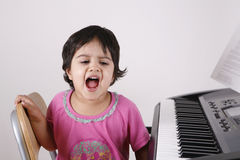 Kid playing a keyboard Royalty Free Stock Photos
