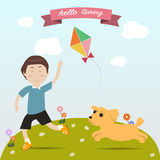 Kid playing kite with  dog on the spring time Stock Photo