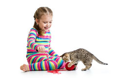 Kid playing with kitten Royalty Free Stock Photography