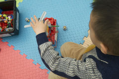 Kid playing lego Stock Images