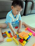 Kid Playing Lego Blocks Royalty Free Stock Photo