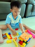 Kid Playing Lego Blocks Stock Photo