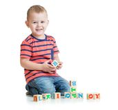 Kid playing with letter blocks isolated Royalty Free Stock Photos