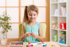 Kid playing modeling plasticine or molding clay Stock Photography