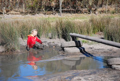 Kid playing in nature Royalty Free Stock Photography