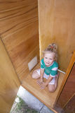 Kid playing in old wardrobe Stock Photo