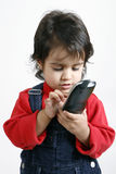 Kid playing with phone Royalty Free Stock Image