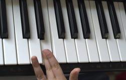 Kid playing piano royalty free stock photo