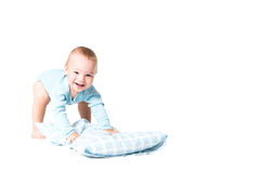 Kid playing with pillow Royalty Free Stock Images