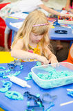 Kid playing with plasticine Stock Image