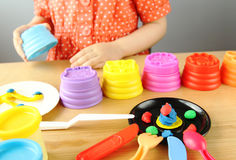 Kid playing with plasticine Royalty Free Stock Images