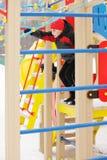 Kid playing at playground Royalty Free Stock Photos