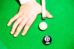 Kid playing pool Royalty Free Stock Photos