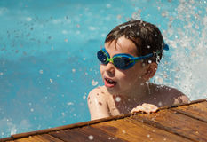 Kid playing in the pool Stock Photography