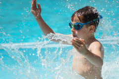 Kid playing in the pool Royalty Free Stock Images
