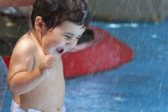 Kid playing in the pool, funny boy in summer Stock Photo