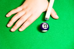 Kid playing pool Royalty Free Stock Image