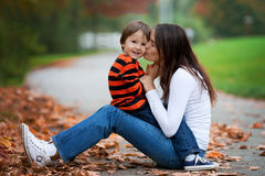 Kid playing  portrait. Young mother her boy Stock Photo