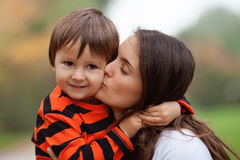 Kid playing  portrait. Young mother her boy Royalty Free Stock Image